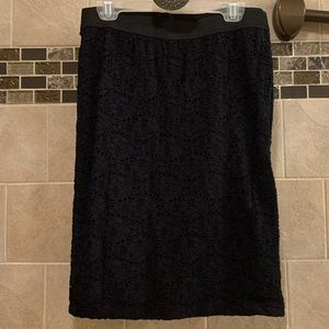 Candies form fitting black lace skirt